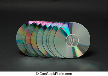 cd's in a row - cd-roms standing up with rainbow colors on a...