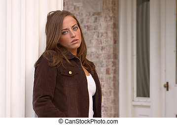 Young Woman 3 - Pretty, young woman posing outside mansion...