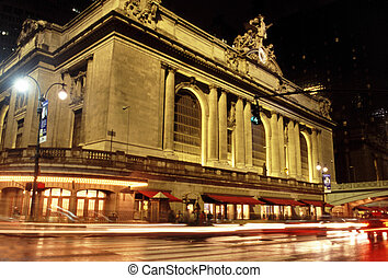 grand central station in new york at night with cars driving...