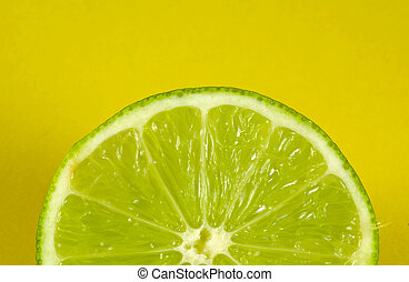Sliced Lime With Yellow Background