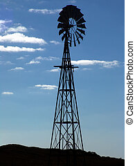 Windmill Silhouette in Rural Australia