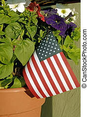 Flowers-flag-pot - A pot of red, white, and blue flowers...