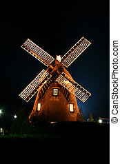 Windmill illuminated - A windmill illuminated by lights at...