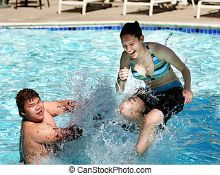 Fun in the pool - 2 kids having good time in the swimming...