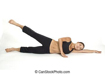Lying Side Leg Raise 2 - A female fitness instructor...