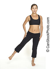 Side Leg Raise 2 - A female fitness instructor demonstrates...