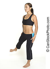Side Leg Raise 4 - A female fitness instructor demonstrates...