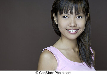 Big Smile 2 - A pretty young asian woman in a pink top with...