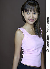 Big Smile 3 - A pretty young asian teenager in a pink top...
