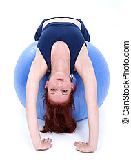 Teen Girl Exercise - Demonstrating back stretch over...