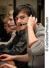 Young adult. - Young adult at a call center, lan party.