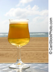 Beach BeerSeries - Full beer glas with beach background