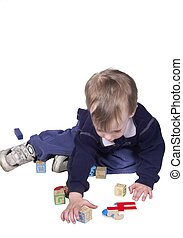 reaching - toddler boy isolated reaching for toys