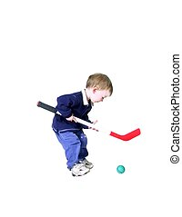 hockey - isolated toddler boy playing hockey
