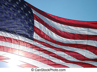 united states flag - a huge flag hanging on a main street in...