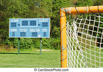 goal and scoreboard - a goal and scoreboard on a small town...
