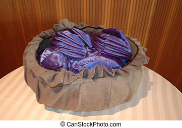 yarmulke 1 - blue yarmulkes in a basket in a temple