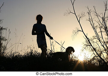 Girl and her dog at sunset