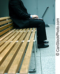 business laptop - business man sitting and working on his...