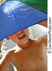 Umbrella Boy - Boy under bright sun umbrella
