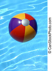 Beach Ball Pool - Bright beach ball in blue pool