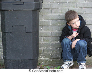 Garbage Can Kid - Little boy against a wall, next to a trash...