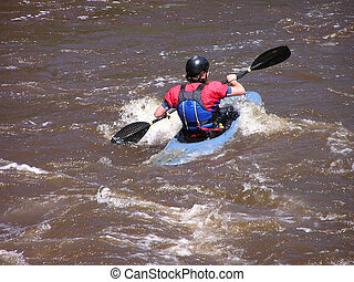 River Kayaker 3 - Kayaker on the Cache la Poudre River near...