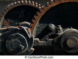 Gears of a sluice gate lift mechanism, the foreground echoed...
