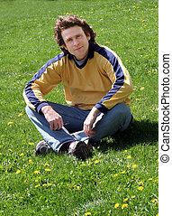 Man on grass - Man sitting on grass