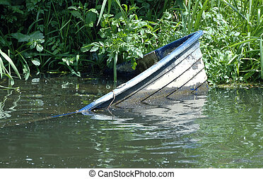 Sinking boat in River