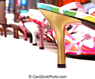Woman shoes stand with selective artistic dof.