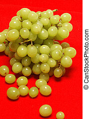 grapes on red background