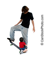 Brothers Skateboard - Big brother teaching little brother...