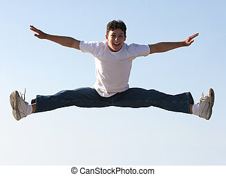 Boy jumping - Boy making a split high in the air