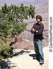 Boy Teen Tourist - Teen boy sightseer standing near edge of...