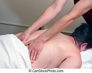 masseuse at work - masseuse massaging woman's back