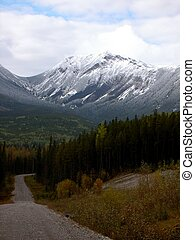 Mountain Road - Outback gravel road with mountain backdrop -...
