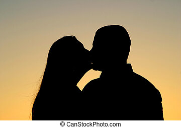 Silhouette Kiss - Beautiful silhouette of a man and woman...
