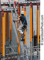 construction ladder - construction worker climbing a ladder