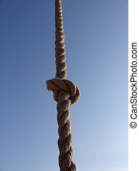 division line - rope with a knot, blue sky in background