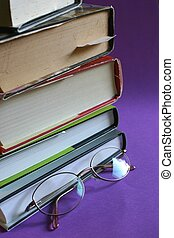 Books and Glasses - A stack / pile of hardcover books with a...