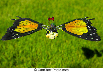 Toy Butterfly in Flight