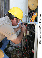 AC Tech Test Voltage - An air conditioning technician...