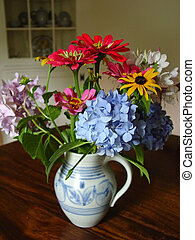 Flowers in pitcher - A colorful bouquet in an antique...