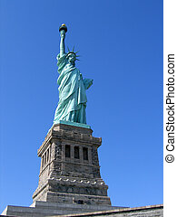 Statue of Liberty against blue sky.