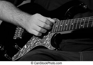 Electric Guitarist 1 - A hand playing an electric guitar