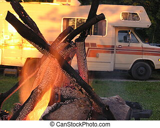 Campfire and camper - Campfire with camper in background