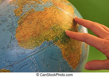 World Globe - Hand pointing at world globe