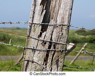 Fence post - A weather-beaten railway sleeper Sunbleached...