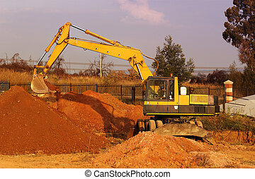 Earthmoving Equipment - Yellow caterpillar digging